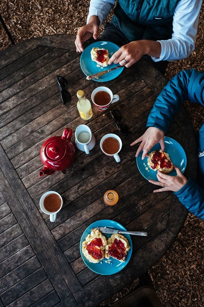 Two people having a cream tea