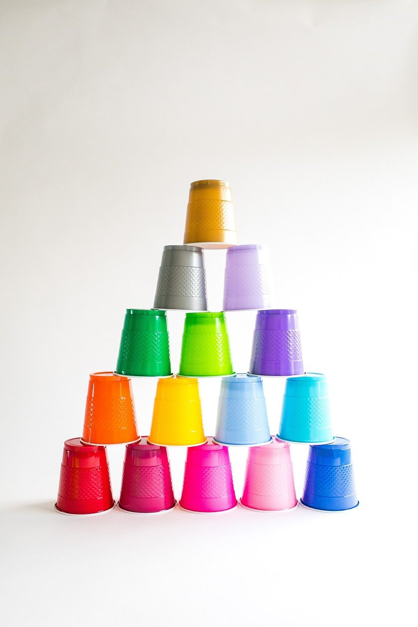 Colourful cups stacked in a pyramid to show inclusive workplaces.
