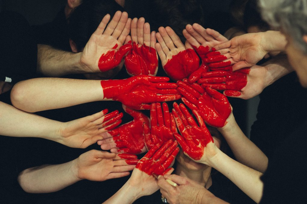 Lots of Hands making a heart in red