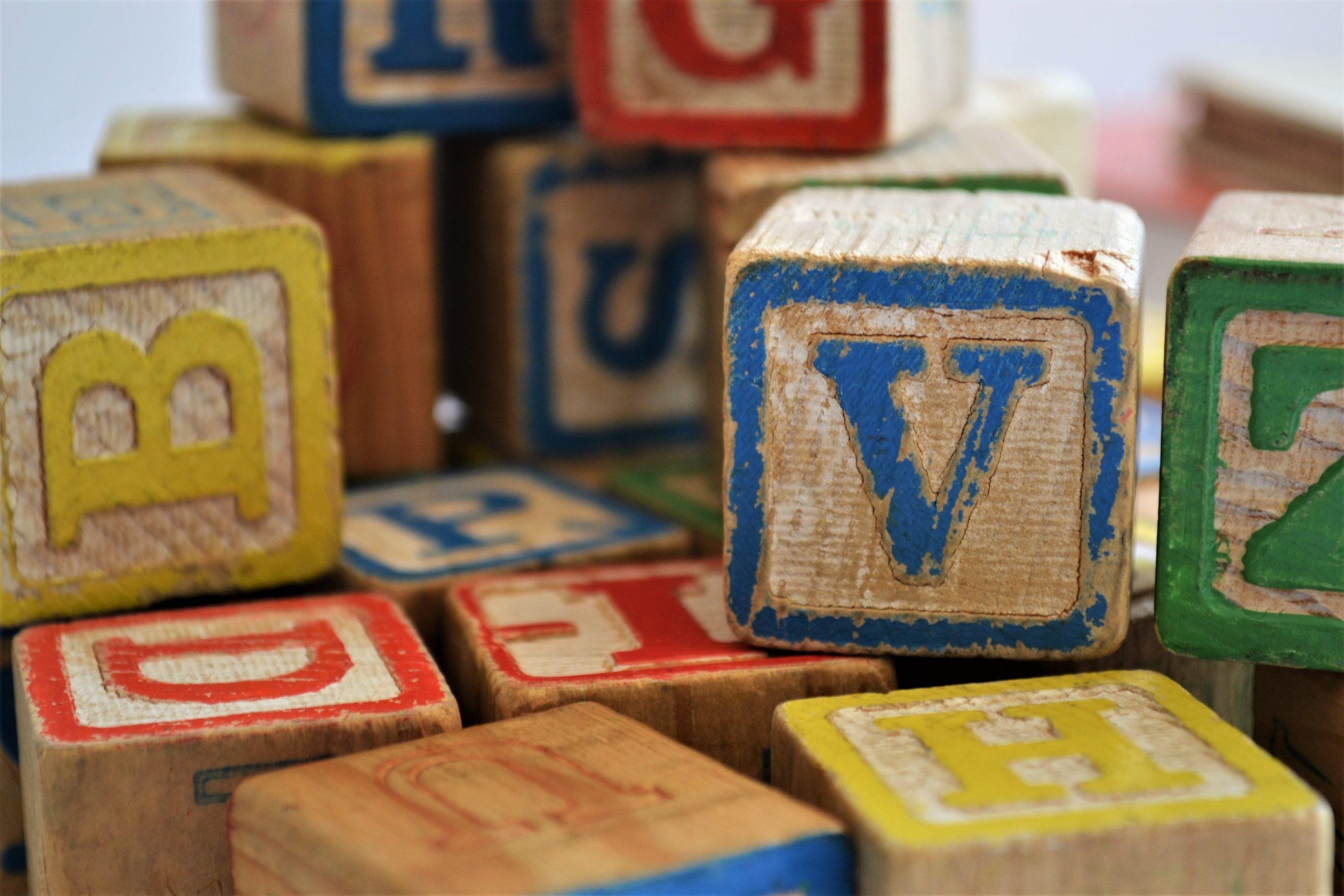 Alphabet Blocks to show how Inclusive Language Create Belonging