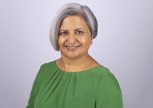 A photo of Raksha Bhalsod  in a green top.